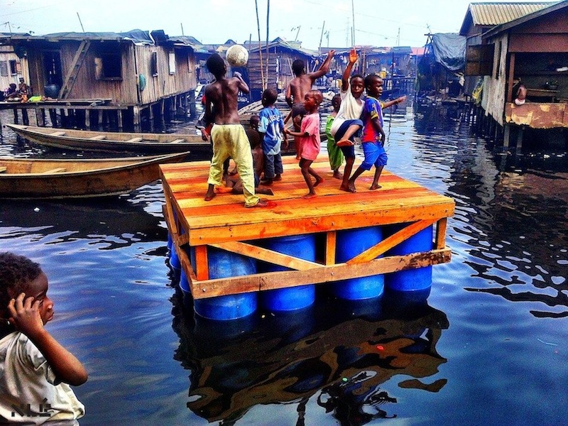 Mokoko Floating School - Kids playing on a platform prototype during construction. Photo: courtesy of NLÉ.