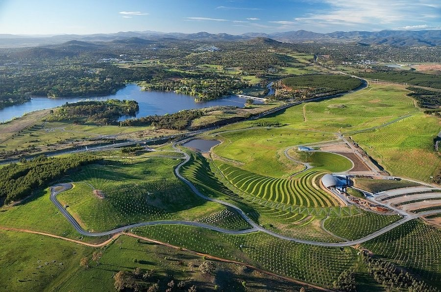 The National Arboretum by TCL in Canberra, Australia. Large terraced earth sculptures form the major arrival sequence into the Arboretum. At the base, a carefully designed irrigation system directs water to the dam to redistribute back into the Arboretum. Photograph by John Gollings.