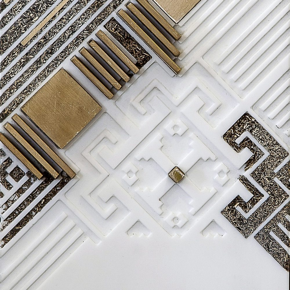 Nermeen Abu-Dail: Detail of Takween 2, Composition 2. Wall hanging artwork - White Corian with copper and copper in lay, 15x43 cm. Photo taken Nabeel Qutteineh.