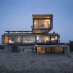 Luciano Kruk stacks concrete and glass volumes for Golf House panoramic villa