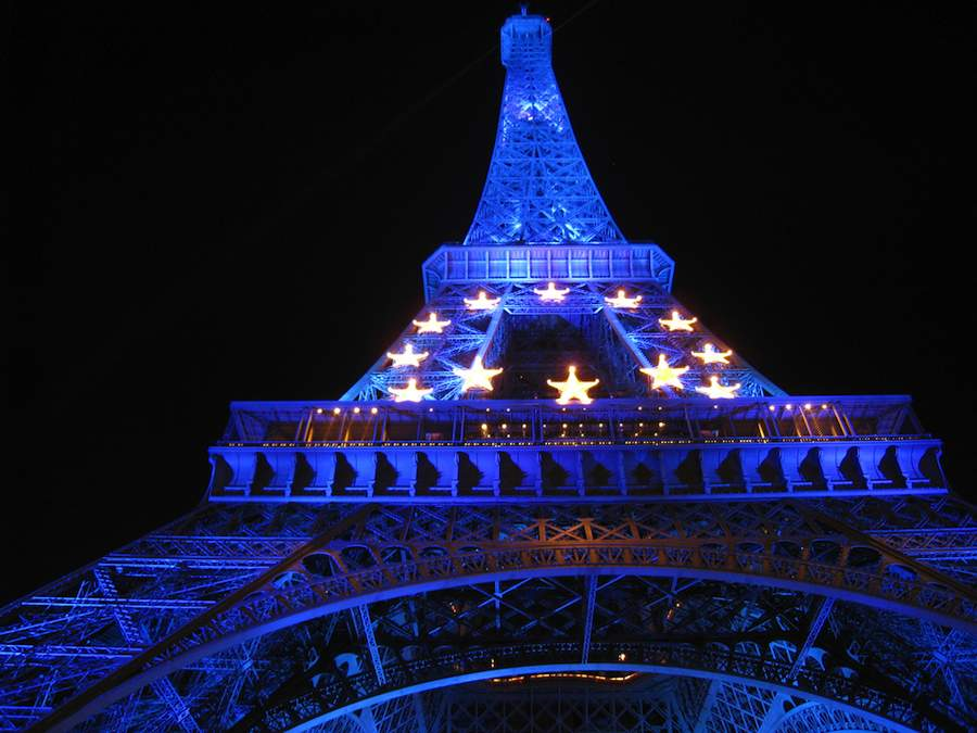 Tour Eifeel, Paris, lit with the EU flag - Photo by Kurt Hunter, Flickr CC