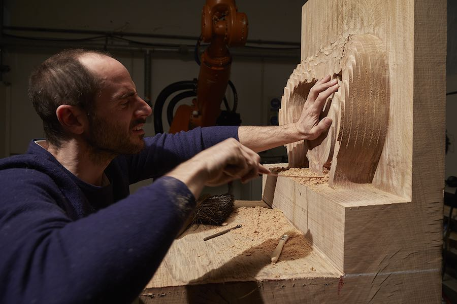 Gareth Neal carving the Hack Chair II featuring a robotic arm - Photo by Petr Krejci Photography. courtesy of Sarah Myerscough.