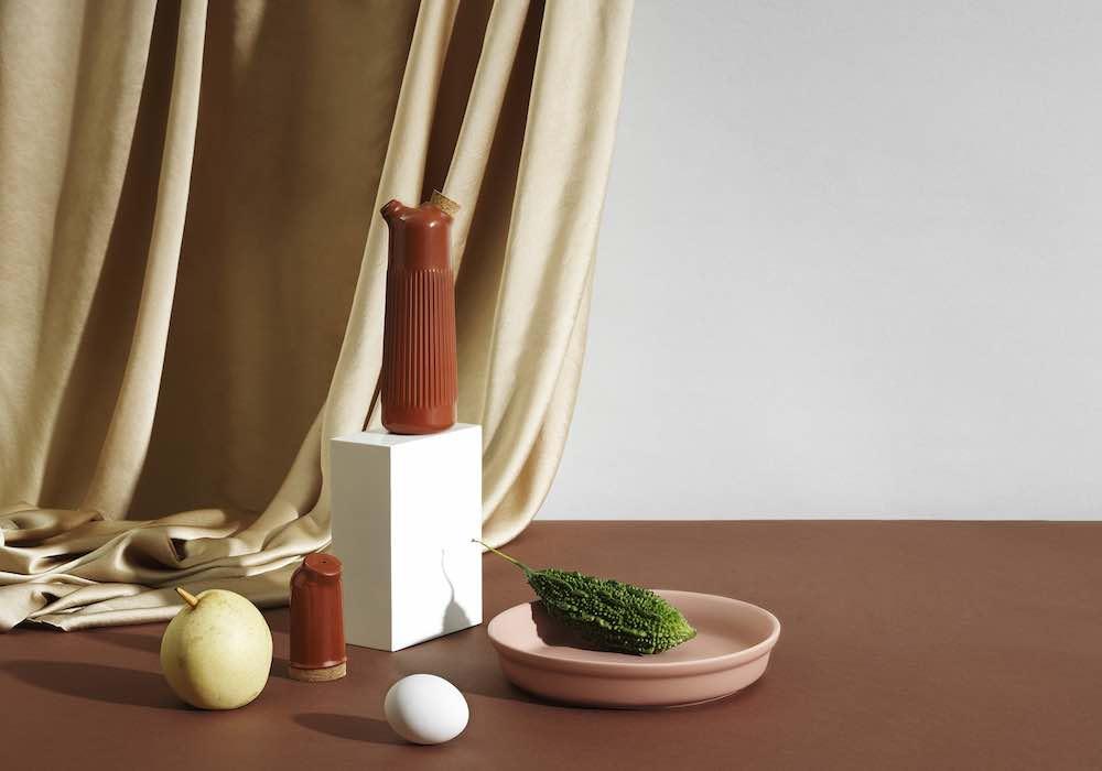 Normann Copenhagen terracotta and ceramic tableware. Junto oil bottle and pepper shaker with Obi bowl - Photo by Normann Copenhagen.