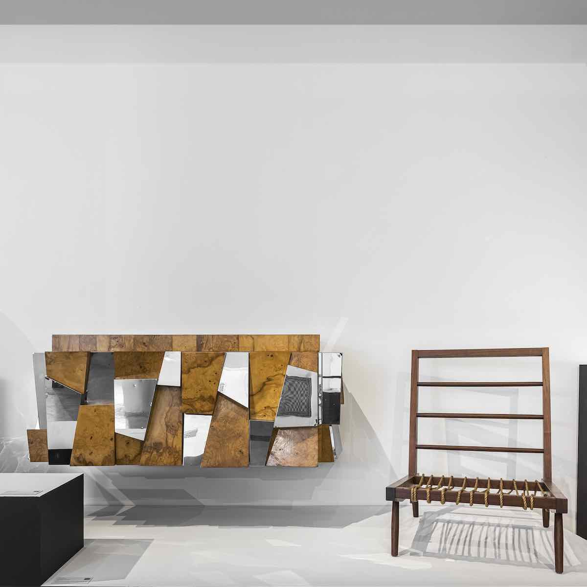 DesignMiami 2020 - from left Paul Evans 'Faceted' wall-mounted cabinet and George Nakashima Prototype Cushion Lounge Chair @ DesignMiami Podium - Photo by Kris Tamburello.