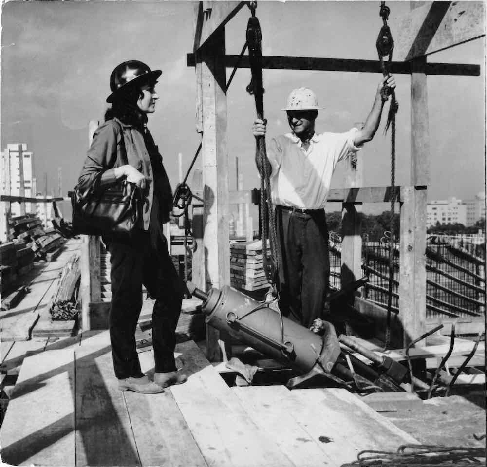Celebrating Women in Architecture - Above portrait of Lina Bo Bardi at the MASP building construction site - Courtesy of Instituto Bardi